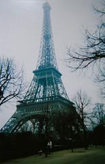 La Tour Eiffel (Melissa O'Donohue) Tags: travel paris france classic film beautiful architecture vintage french march spring iron europe pretty awesome wroughtiron eiffeltower eiffel 2006 wanderlust latoureiffel champdemars huge disposablecamera worldsfair traveler gustaveeiffel puddlediron