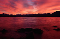 Lake Tekapo at dawn (Paul Newbon) Tags: longexposure travel red newzealand lake snow motion blur mountains clouds sunrise dawn nikon glacier adventure laketekapo redsky