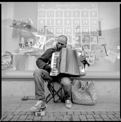 Street musician, Oudegracht Utrecht (Pim Geerts) Tags: street portrait musician music white man black guy 6x6 film analog dark square utrecht angle zwartwit kodak homeless wide accordion ps bronica format 40mm portret harmonica sqa oudegracht straat straatmuzikant muzikant analoog tx400 dakloos tambourin groothoek trekzak tamboerijn bandoleon ps40mm