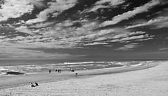 Nordsee / North Sea (schreibtnix on'n off) Tags: sky people holland travelling beach nature netherlands clouds strand reisen natur himmel wolken menschen northsea blacknwhite nordsee callantsoog schwarzweis olympuse5 schreibtnix