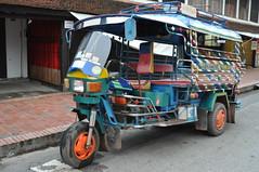 This sturdy tuktuk has brought in some tourists (oldandsolo) Tags: southeastasia earlymorning buddhism tourists lp laos tuk luangprabang buddhistmonk laopdr makingmerit unescoworldheritagecity buddhistreligion takbat buddhistfaith luangprabangpublictransportjumbo tuktukjumbo morningalmsgivingritualluangprabang morningalmsgivinginluangprabang