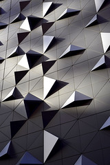The wall has dimples (bobarcpics) Tags: metalcladding triangles wall melbourne shadows