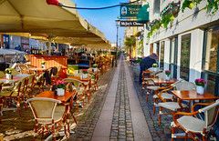 Restaurants in Copenhagen, Denmark (` Toshio ') Tags: toshio denmark copenhagen danish europe european europeanunion restaurants sidewalk table chairs fujixe2 xe2 irishpub harbor