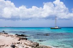 Caribbean Sea (Haydelis) Tags: sea mar caribe azul blue beach aruba caribbeansea sunset sun boat colores colors canon canont3 canonphotography haydelis travel landscape
