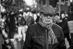 Black Friday Lingers (Leanne Boulton) Tags: people monochrome depthoffield bokeh outdoor urban street candid portrait portraiture streetphotography candidstreetphotography closeup candidportrait streetlife elderly old man male face facial expression look emotion feeling mood atmosphere dour sadness misery jowls cap busy winter tone texture detail natural light shade shadow city scene human life living humanity society culture canon 5d 5dmarkiii 70mm character ef2470mmf28liiusm black white blackwhite bw mono blackandwhite glasgow scotland uk