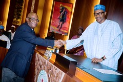 President Buhari congratulating Justice W.S.N. Onnhogen shortly after being Sworn-In as the Acting Chief Justice of Nigeria in State House