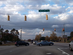 Waiting To Turn On To Liberty Hill Drive. (dccradio) Tags: lumberton nc northcarolina robesoncounty libertyhillroad fayetteville road clouds sky tree trees redlight trafficlight powerlines electriclines utilitylines roadsign rubytuesday restaurant pavement street intersection chevy chevrolet equinox