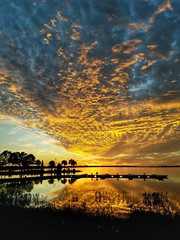 December sunset in FL (PointOfUPhotography) Tags: december beautifulclouds goldensunset florida reflection lake clouds breathtaking sunset