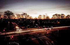 A street crossing sunset (densshod) Tags: sweden sky sun sunlight sunset winter longexposure light lines lightpost outdoor olympus out contrast color clouds halmstad halland house