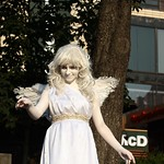 White angel on the streets of city.   (series)
