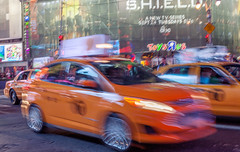 Cabs (JMS2) Tags: motion cars yellow canon movement manhattan taxi blurred timessquare cabs fare