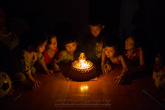 Happy Birthday~ (AT.Photography) Tags: life family light red portrait favorite orange black cute art home beautiful smile childhood cake closeup kids night composition contrast dark print children fun happy amazing lowlight singapore asia candle bright little sweet great chinese adorable indoor livingroom age happybirthday 24 24mm lovely fullframe staring 6d 2414 2013