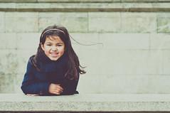 Marine Girl [+4] [Explored] (marywilson's eye) Tags: blue portrait espaa cute girl smile azul stone wall vintage hair fun pared happy 50mm kid spain nikon marine corua long child julia wind lock retrato happiness viento retro nia galicia linda sonrisa breeze marino diversion nautico piedra brisa d90 mechn vsco