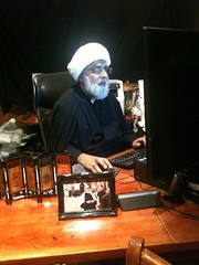 Sheikh at his desk writing in Sydney