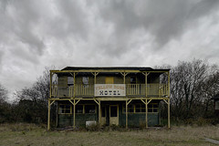 The Wild West (Subversive Photography) Tags: uk trees abandoned set clouds movie hotel cowboy moody decay urbandecay surreal urbanexploration ghosttown subversive derelict wildwest themepark urbex westerner americanised