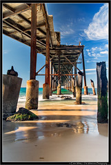 Underneath (Emma White ( ... somewhere ... )) Tags: ocean sea white seascape water reflections newcastle landscape bay pier sand nikon photographer jetty hill emma catherine wharf nsw coal pylons d7100 thewhiteview