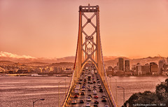 Bay Bridge connecting San Francisco and Oakland (nicksimages.com) Tags: auto sanfrancisco california road city travel bridge sunset sea summer urban usa cars water architecture america buildings drive oakland bay coast twilight construction highway downtown cityscape traffic unitedstates pacific northwest dusk famous engineering landmark transportation transit tall rushhour jam