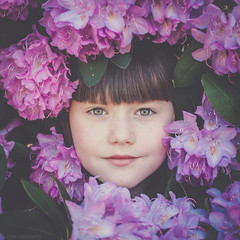 Spring has Sprung (Kilkennycat) Tags: pink flowers portrait girl smile canon children happy spring child greeneyes rhododendron pancake bangs 500d kilkennycat 40mm28 t1i ryanconners