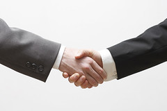 handshake () Tags: people man male businessman modern standing work computer person corporate office hand looking dress adult employment good contemporary young formal tie kind professional communication celebration business suit human giving deal shake ready consultant service handshake worker casual contact positive welcome gesture job success greeting bt confident representative agreement hired minded businessperson  briantracycokr