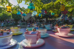 Dizzy Disney Teacups in Golden Light (aaronrhawkins) Tags: teacup ride disneyland blur colorful party tea spin line crowded fun aliceinwonderland vacation family longexposure afternoon motionsickness