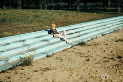 Playground Love (David Pinzer) Tags: people portrait girl emotive sensual body pool summer outdoor abandoned