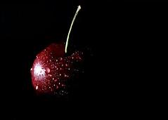 Red Cherry (For Comp) (ReeceDonaldson) Tags: cherry red water droplets dew black macro dof depth colour fruit burst explsion explosion juicy food moist refreshing plump ripe contrast fade dark light vs shine reflect spotlight home