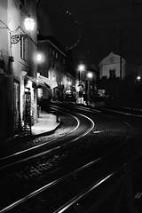 Folow the line (rienschrier) Tags: monochroom stad city rain straat street lisboa tram rails reflexi lissabon balckandwhite zwartwit night nacht