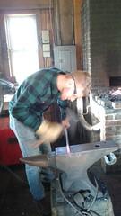 Alex hammering on the anvil (Ken_Mayer) Tags: uploadedwithflync blacksmith forge kinderfarm maryland anvil hammer poker