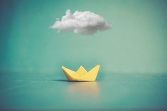 Floating with cloud of glory... (Ayeshadows) Tags: paper boat sea cloud single float glory texture yellow torquise seagreen
