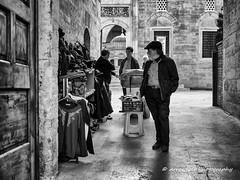 Street 219 (`ARroWCoLT) Tags: bnw bnwstreet people streetart cami üsküdar istanbul türkiye türkei turkey street sokak samsung photography outdoor siyahbeyaz art bw blackwhite monochrome blackandwhite arrowcolt nx300 oldman bokeh 30mm f2 streetvendor ishootpeople mosque avlu door ancient historical