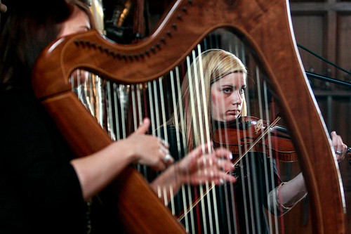 A harpist and violinist playing at the Edinburgh Castle Reception