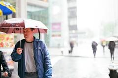 it's 8am on monday morning and i'm soaking wet please don't take my picture (september.) Tags: street nyc newyorkcity film rain umbrella 35mm upperwestside canonae1 columbuscircle raining canonfd50mmf14 canonfd fujifilmsuperia400