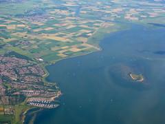 Coast (K.G.Hawes) Tags: city sea water netherlands airplane landscape island coast town view farm air creative plan commons aeroplane aerial cc creativecommons farms