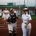 120815-C-ZZ999-002 ROSEMONT, Ill. (Aug. 15, 2012) -- Chicago Bandits catcher Kristen Butler congratulates Navy Ensign Courtney Banske following her solid ceremonial first pitch before the Chicago Bandits vs. the Carolina Diamonds game on Wednesday evening