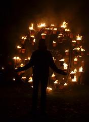 Silhouetted (dr_urbanus (Martin)) Tags: silhouette night dark person lumiere fireball derry stcolumbspark ilovelumiere