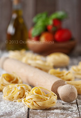 Raw pasta (Oxana Denezhkina) Tags: italy food white cooking kitchen yellow closeup dinner recipe table cuisine wooden healthy italian mediterranean raw pin dough background wheat traditional egg culture tasty pasta fresh gourmet homemade meal noodles spaghetti flour making rolling preparation linguine tagliatelle preparing ingredient uncooked