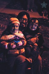 340 of 365 - Two Bugs Snug ... ([ the black star ]) Tags: friends boy man cold girl kids outside glasses sitting smiles things dude adventure kingston stuff anthony coats jackets shrug goodtimes isobel christmasparade preschooler 2013 340365 theblackstar threehundredforty