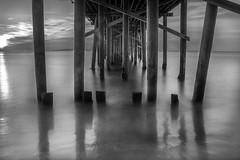 Post It (toddworton) Tags: ocean longexposure blackandwhite black sunrise pier malibu
