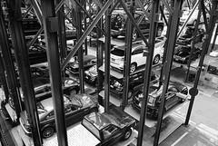 Stacked (bhop) Tags: new leica york nyc bw ny cars film kodak parking voigtlander 28mm trix rangefinder tourist f2 m6 premium ultron arista