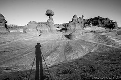 Photographer in Action (Squirrel Girl cbk) Tags: bw utah unitedstates greenriver hoodoos goblinvalleystatepark entradasandstone shadowphotographer