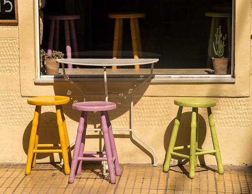 pastel-colored stools in Sitia - Σητεία
