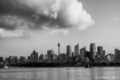 Looming Over Sydney (orgazmo) Tags: fuji fujifilm fujix fujinon xf55200mmf3548ois xpro2 landscapes cityscapes sydney sydneyharbour skylines clouds cloudformations rainclouds cityscape sky skyscapes newsouthwales nsw blackwhite monochrome australia downunder