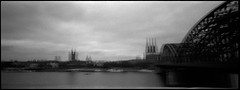Cologne Skyline (antonis.kioupliotis) Tags: hohenzollernbridge cologne germany kodaktrix film blackandwhite koelnerdom cologneskyline pinholephotography