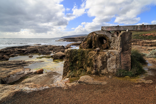 Waterwheel remains on rocky beach