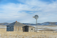 Lonely Windmill (tomkellyphoto) Tags: lusk wyoming lonely desolate sky clouds prairie desert windmill snow winter usa