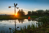 19okt2016c (mesocyclone70) Tags: mill windmill water lake canal reflection autumn fall holland europe netherlands sun sunset flare lensflare green sky evening nature river light blue clouds cloud color colors colour colours colorfull colourfull