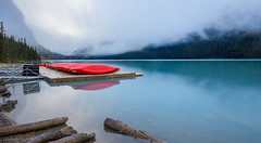 Lake Louise Boat Dock (1ns0mn1ac) Tags: banffnationalpark canada sunrise rockiestrip lakelouise canadianrockies labcolorspace photoshop lightroom cloud fog water red boatdock trees blue sky wideangle hdr