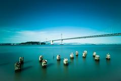 Flat Water (color) (morozgrafix) Tags: longexposure sky water landscape bay clear baybridge pylons weldingglass sigma1020mmf456 nikond5000