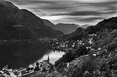 The entering of rain (Ron Jansen - EyeSeeLight Photography) Tags: blackandwhite reflection rain weather norway clouds shade fjord