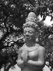 praying (ddmxxxx) Tags: statue stone temple southeastasia buddha buddhist pray praying vietnam saigon hochiminhcity panasoniclumix lumixgf3